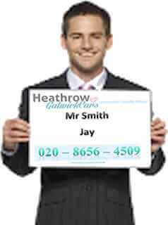 Young Man Holding Heathrow Gatwick Cars Placard