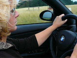 professional driver driving a car on England Country side